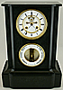 197. A French Bourdon barometer with clock, signed 'Richard A Paris', circa: 1855-1860.
