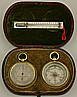 150. An English silver travelling set with aneroid barometer, pedometer and compass, signed 'Negretti & Zambra London', circa: 1875-1890.
