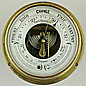 114. A SCOTTISH MARINE ANEROID BAROMETER, signed 'Whyte Thomson & Co Glasgow', circa: 1890-1910.