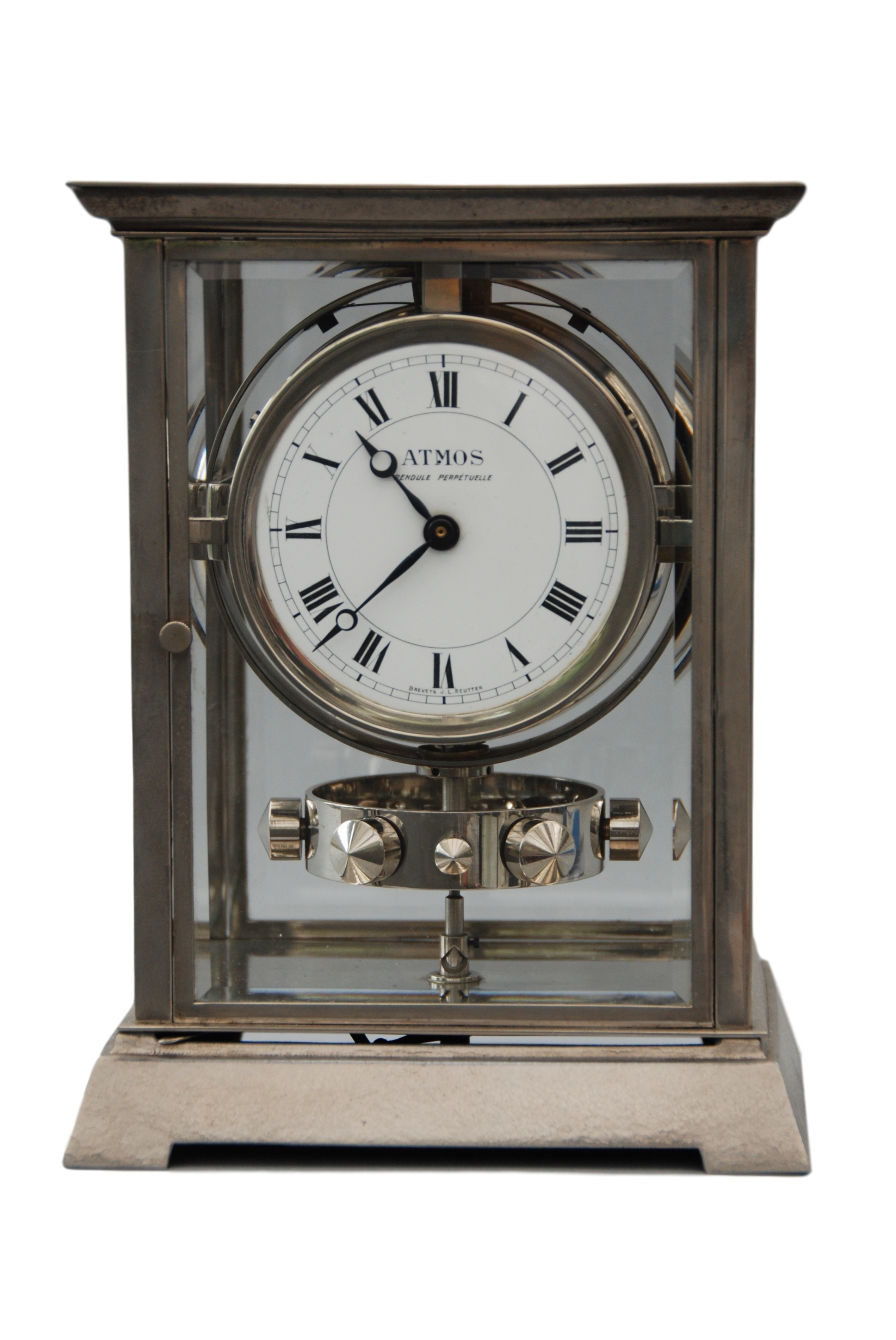 An early 1930 nickel plated art deco style J.L. Reutter four-glass atmos clock, small version.