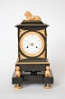 A French patinated and gilt bronze mantel clock with date indication, Trouvarelles A Paris, circa 1800